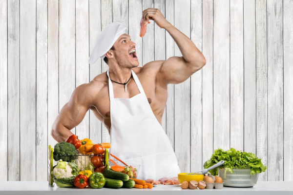 depositphotos_229386556-stock-photo-man-bodybuilder-cooking-kitchen-white